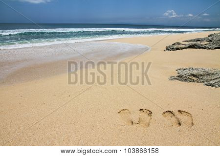 Beach With Footsteps And Stones-bali,indonesia
