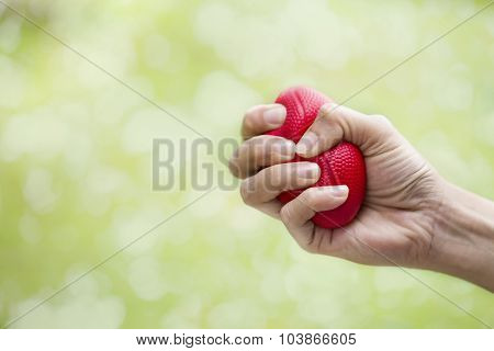 Woman Hand Squeezing A Stress Ball
