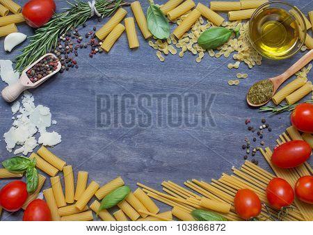 Pasta, Condiment And Tomato On Wooden Background