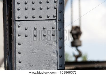 Solid Crane Steel With Rivets And A Crane Hook