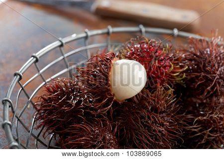 Rambutan fruits on a rustic table