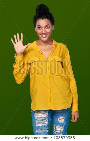 Woman showing five fingers