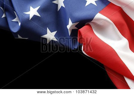 Closeup of American flag on black background