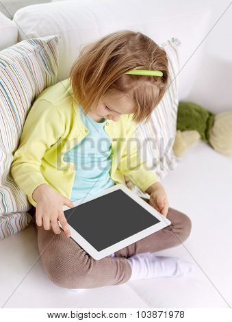leisure, technology and children concept - little girl with tablet computer at home