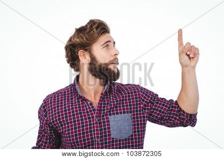 Hipster pointing upwards against white background
