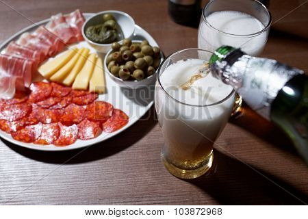 Beer and antipasto on a table