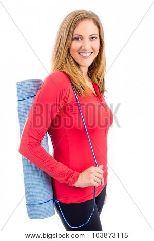 Woman holding her yoga mat isolated on white background