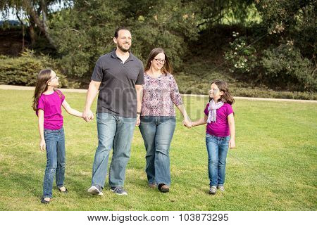Happy family spending time in the park