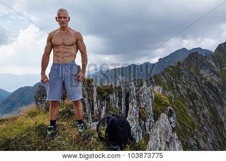 Shirtless Athletic Man On Mountain Top