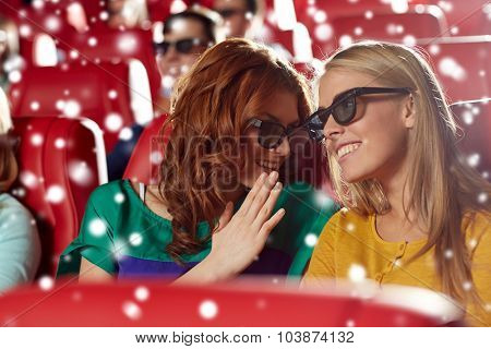 cinema, technology, entertainment and people concept - happy female friends with 3d glasses watching movie and whispering in theater over snowflakes
