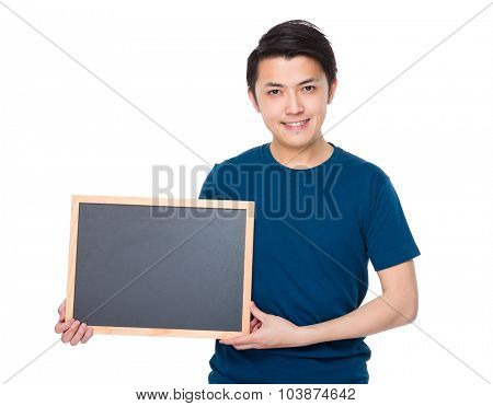 Young man showing chalkboard