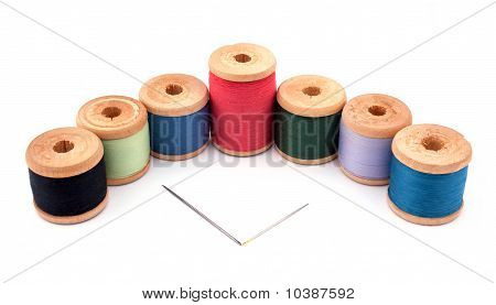 Thread spools isolated on the white