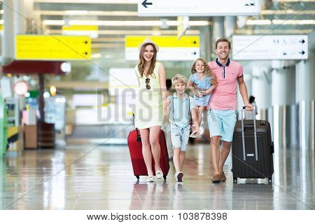 Happy family with children at the airport