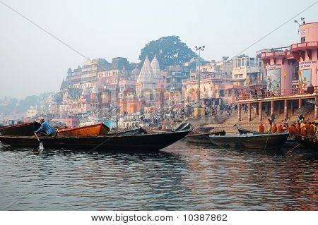 Hindus perform ritual puja at dawn in the Ganges River on December 20 2007 in Varanasi