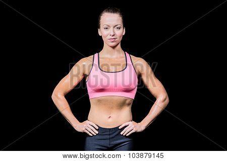 Portrait of confident slim woman against black background