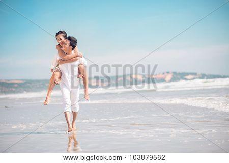 Piggybacking On The Beach