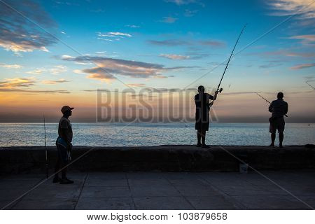 Group Of Friend Fishing At Malecon,  In Havana, Cuba.
