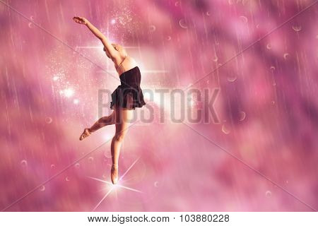 Pretty ballerina dancing against path in autumnal forest