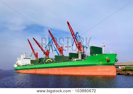 The Ship In Port Under Loading And Unloading