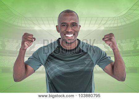 Portrait of rugby player cheering after success in game against green vignette