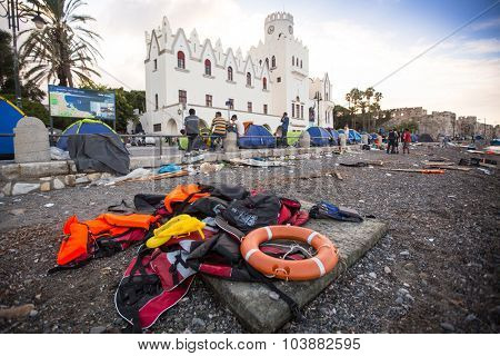 KOS, GREECE - SEP 28, 2015: Life Jackets discarded and sunken Turkish boat in the port. Kos island is located just 4 kilometers from the Turkish coast, and many refugees come from Turkey in boats.