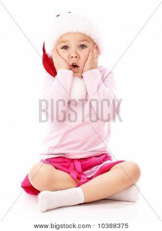 Little Girl Wearing Red Christmas Cap