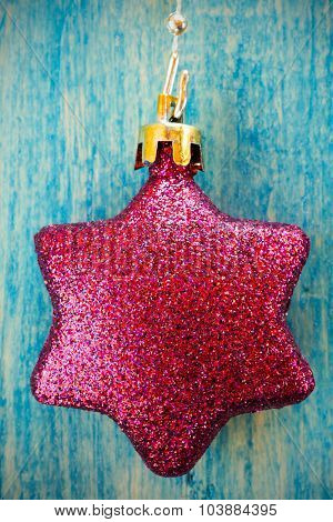 Christmas Bauble Hanging On Wooden Background