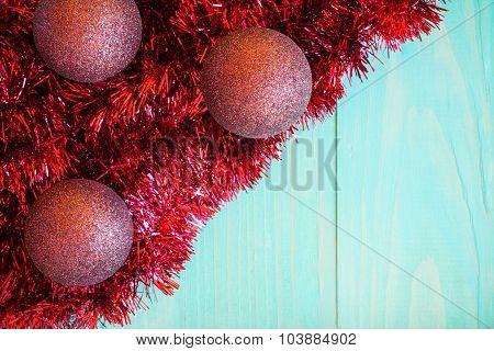 Red Tinsel And Christmas Balls