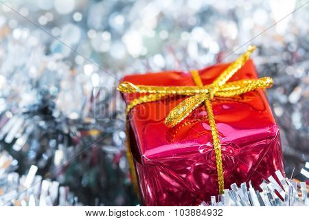 Silver Tinsel And Red Gift Box