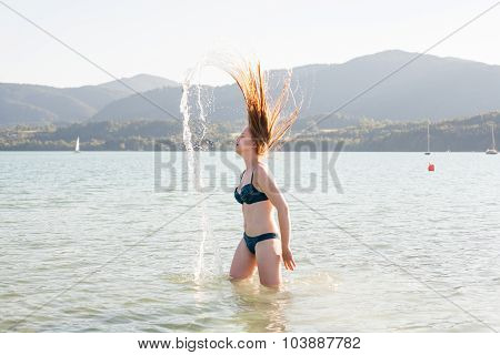 Woman In Lake Flipping Wet Hair Dramatically