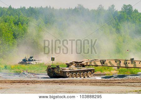 Bridge layer MTU-72 in action under tank cover