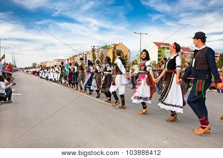 NOVI SAD, SERBIA-OCT 4, 2015: Guinness World Record Largest Folk Dance on Oct 4. 2015 in Novi Sad, Serbia. Over 12.000 participants break the Guinness World Record by simultaneously dancing a Kolo