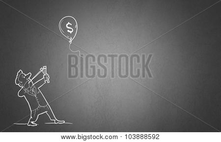 Caricature of businessman shooting in flying dollar balloon