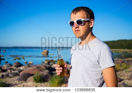 Handsome Man With Bottle Of Beer On The Beach