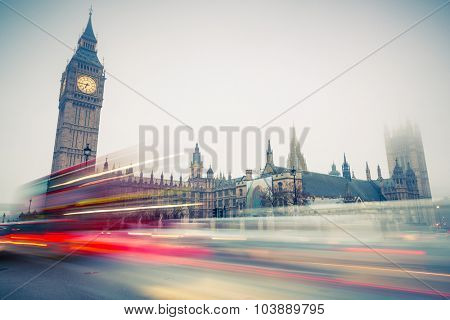 Big Ben and moving double-decker bus in London, UK