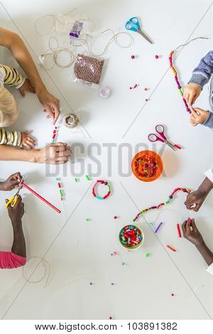 Children Doing Bead Work