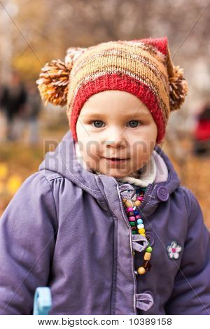 Beautiful Baby Portrait Outdoor Against Autumn Nature