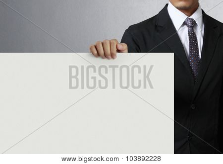 holding white a blank billboard