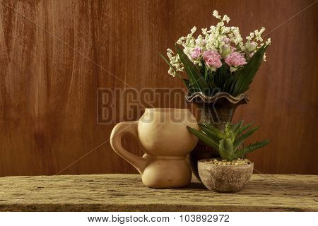 Flowers And Earthenware In Still Life Style