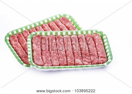 Sausages In A Tray Isolated On A White Background