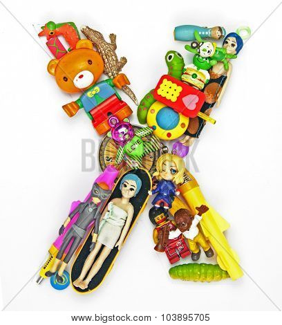 the letter     X  made from small toys