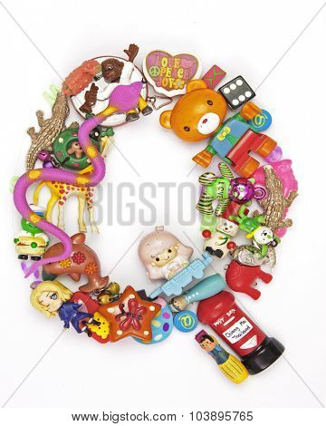 the letter Q made from small toys