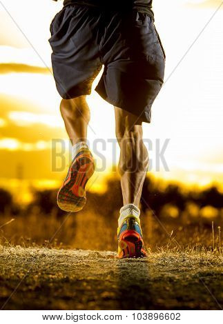 Young Man Strong Legs Off Road Trail Running At Amazing Summer Sunset In Sport And Healthy Lifestyle