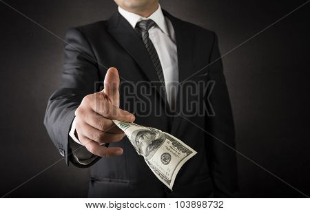 Businessman Giving Dollar