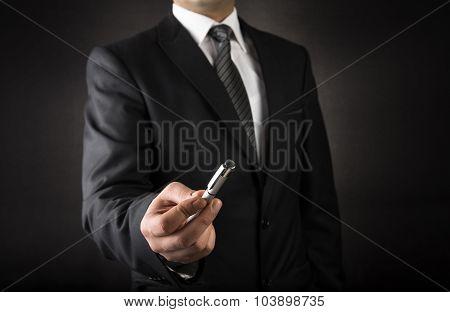 Businessman offering a pen