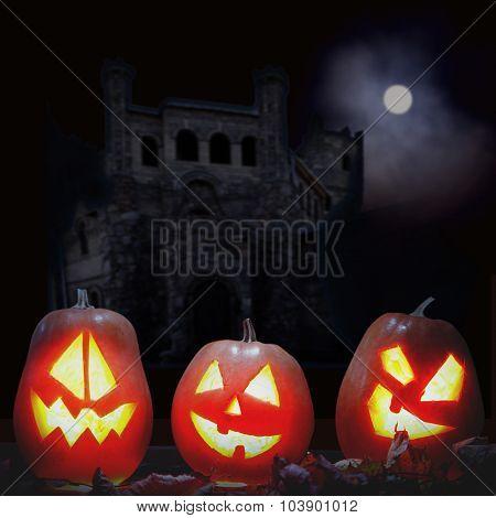 Jack o lanterns Halloween pumpkin face on sinister castle and moon background