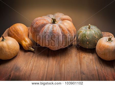 autumn pumpkins a on a wooden table