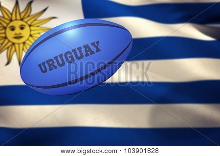 Uruguay rugby ball against close-up of uruguayan flag