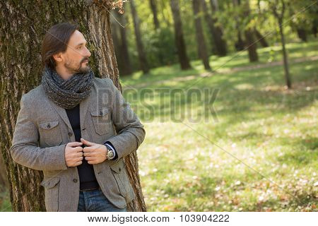 Handsome middle-aged man in the park