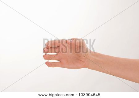 Woman's hand as if holding a bottle